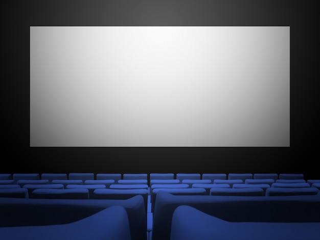 Cinéma Cinéma Avec Sièges En Velours Bleu Et écran Blanc Vierge. Photo Premium
