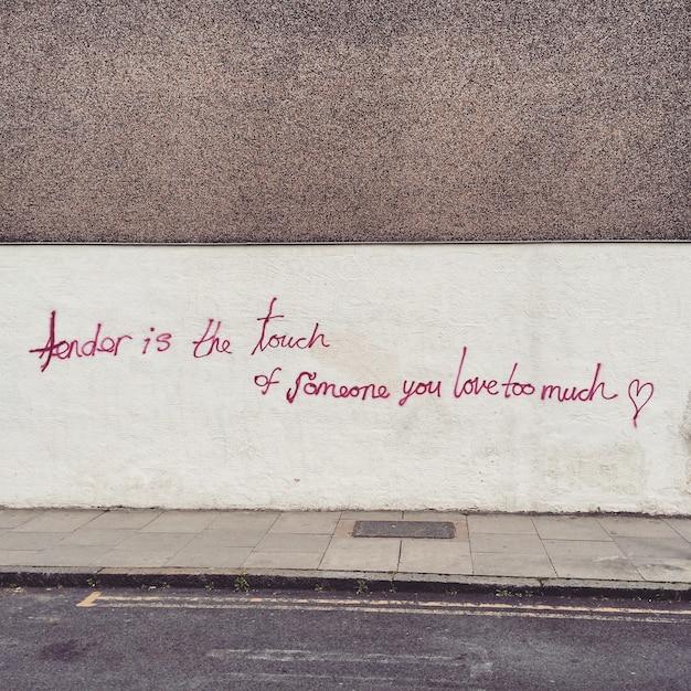Citation dans le mur de la rue Photo gratuit