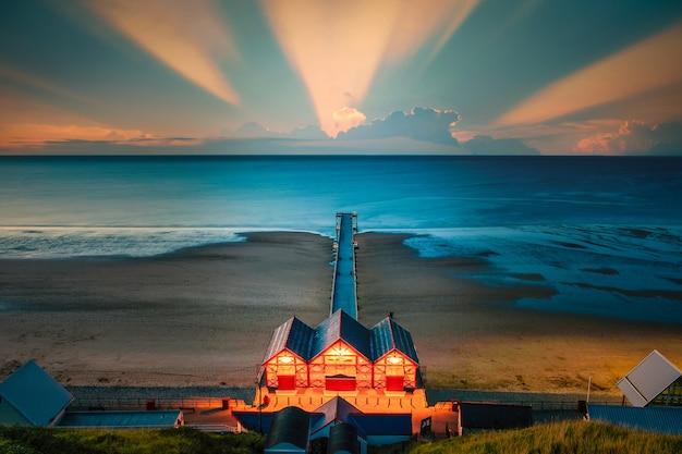 Clifftop View Of Pier Au Coucher Du Soleil De Saltburn By The Sea, North Yorkshire, Uk Photo Premium