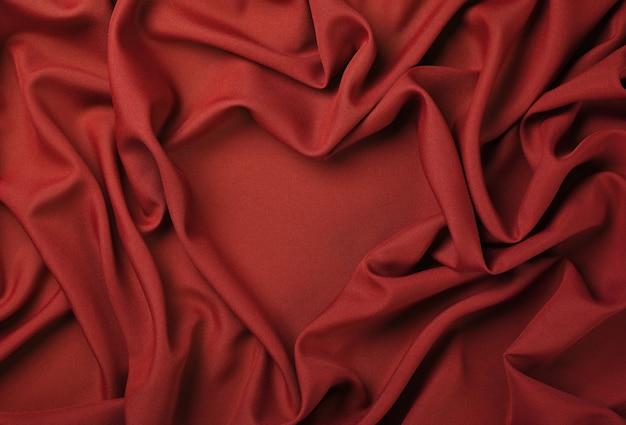 Close Up Abstract Background Textile De Plis Pliés Rouges En Forme De Coeur De Tissu, Vue De Dessus, Directement Au-dessus Photo Premium