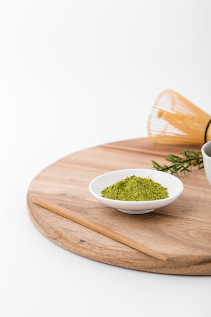 Close-up bowl avec de la poudre de matcha Photo gratuit