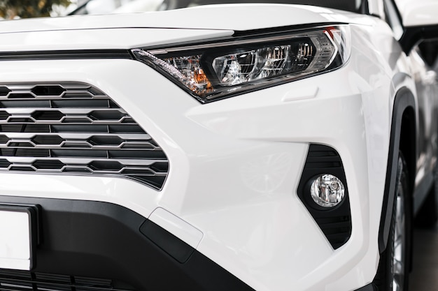 Closeup phares de voitures modernes et de luxe. détail extérieur Photo Premium