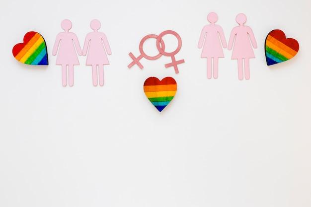 Coeurs arc-en-ciel avec des icônes de couples lesbiens Photo gratuit