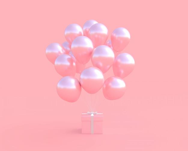 Coffret rose avec ballon sur fond rose. Photo Premium
