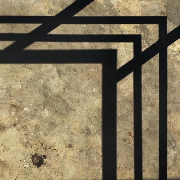 Coin géométrique sur ciment Photo gratuit