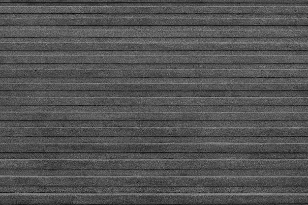 Coin gros plan de la texture de l'escalier de marbre extérieur des escaliers en pierre noire. Photo Premium
