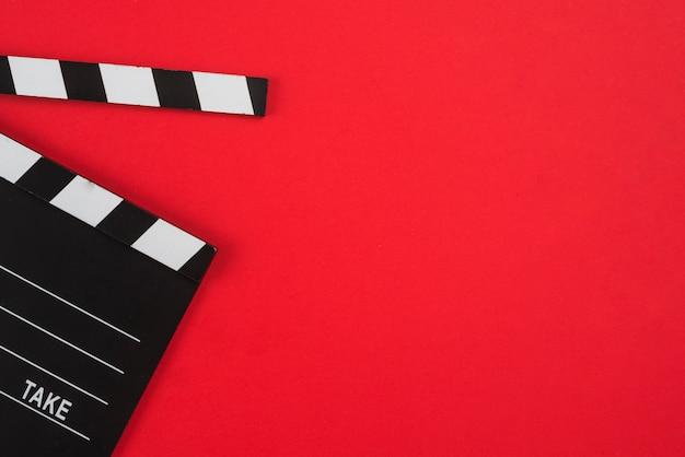 Composition laïque à plat d'objets de cinéma Photo gratuit