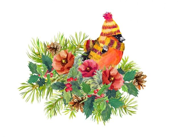Composition de noël - oiseau pinson, fleurs d'hiver, épinette, gui Photo Premium