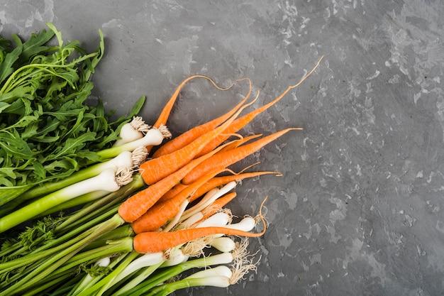 Composition à plat de légumes avec fond Photo gratuit