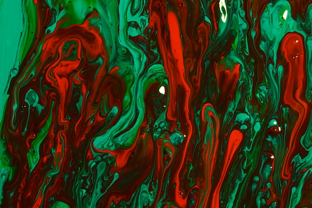 Composition de la vue de dessus avec de la peinture rouge et verte Photo gratuit