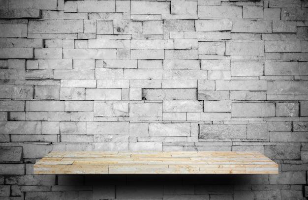 Comptoir d'étagère en pierre sur une couche de pierre grise pour l'affichage des produits Photo Premium