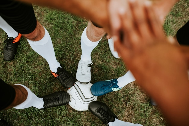 Concept d'esprit d'équipe de joueurs de football Photo Premium