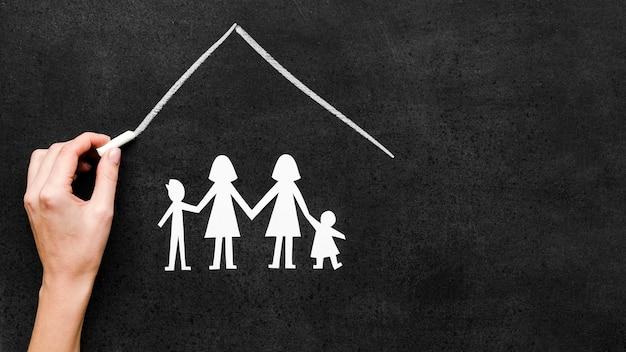 Concept De Famille De Craie Dessiné Sur Tableau Noir Photo gratuit