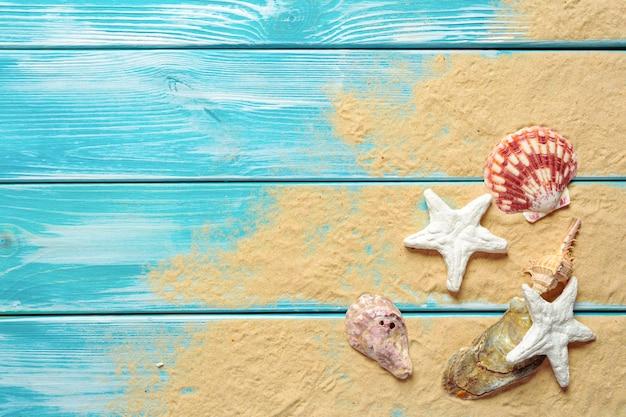 Concept de l'heure d'été avec fond de coquillages avec fond Photo Premium