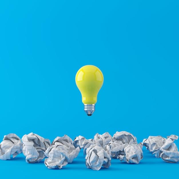 Concept Minimal. Ampoule Jaune Exceptionnelle Flottant Sur Du Papier Froissé Blanc Sur Fond Bleu. Rendu 3d. Photo Premium