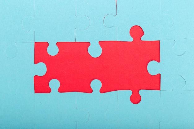 Concept De Puzzle, Fond Bleu Et Rouge Photo Premium