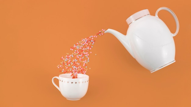 Confettis colorés découlant de la théière dans la tasse blanche sur fond brun Photo gratuit