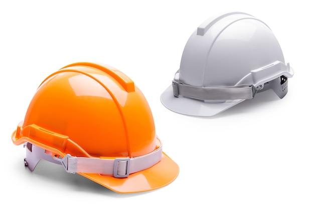 Construction de casque de sécurité blanc orange sur fond blanc. Photo Premium