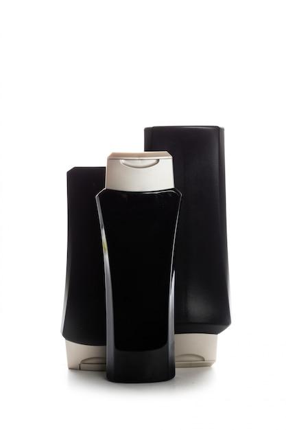 Contenants de cosmétiques isolés sur blanc Photo Premium