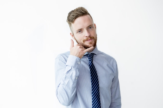 Contenu business man making call me gesture Photo gratuit
