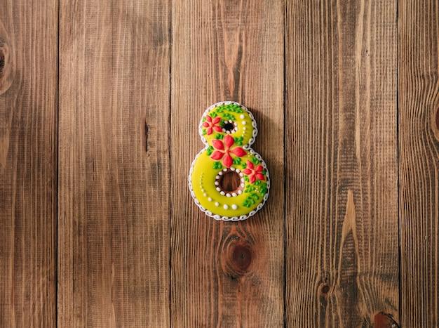 Cookies de vacances glaçage huit jours en bois fond de mères Photo Premium