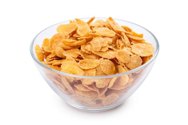 Corn flakes dans un bol isolé Photo Premium