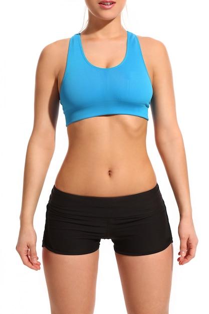 Corps de femme dans une tenue de fitness Photo gratuit