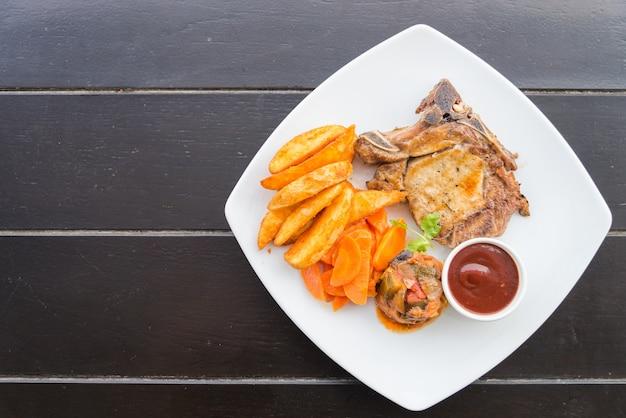 Côtelette de porc bifteck Photo gratuit