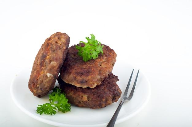 Côtelettes avec un plat Photo Premium