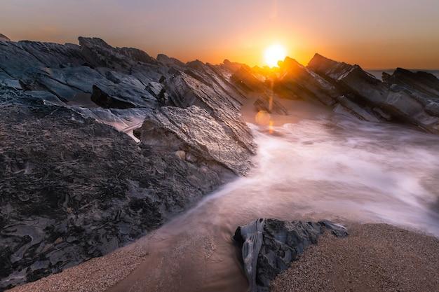 Coucher De Soleil Sur La Plage De Bidart, Pays Basque. Photo Premium