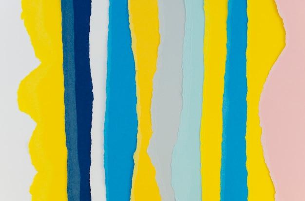 Couches Colorées De Papiers Verticaux Déchirés Photo gratuit