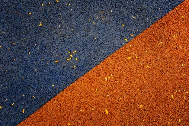 Couleur bleu et orange du revêtement de sol en caoutchouc Photo Premium