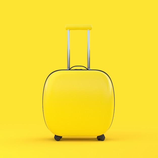 Couleur jaune de valise de voyage isolé avec un tracé de détourage et une maquette pour votre texte Photo Premium