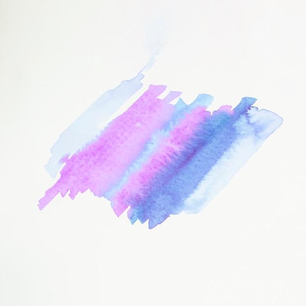 Coup de pinceau abstrait bleu et rose sur du papier blanc Photo gratuit