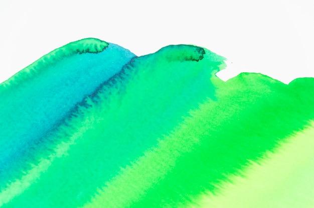 Coup de pinceau aquarelle abstraite sur fond blanc Photo gratuit