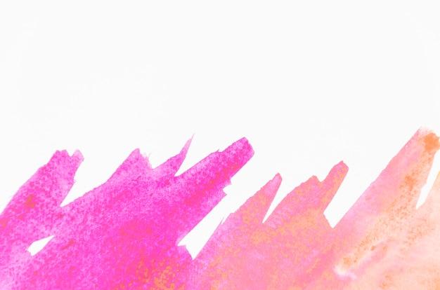 Coup de pinceau aquarelle rose sur fond blanc Photo gratuit