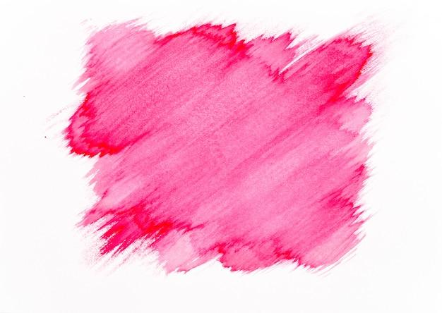 Coup de pinceau aquarelle rouge sur fond de papier blanc. Photo Premium