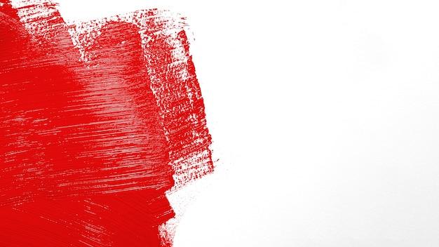 Coup Rouge Vif Sur Le Mur Photo gratuit