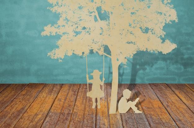 Coupe De Papier D'enfants Lire Un Livre Sous L'arbre Photo gratuit
