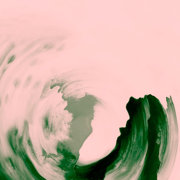 Coups de pinceau de peinture verte sur fond de pêche Photo gratuit