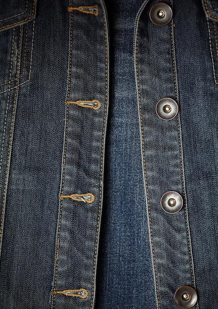 Couture veste en jean et boutons Photo gratuit