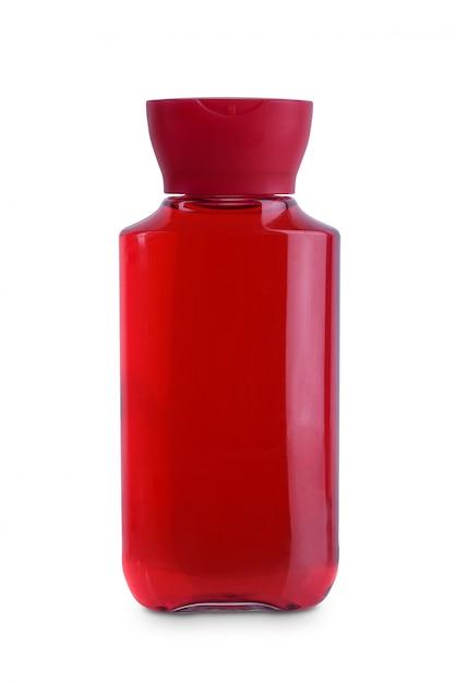 Couvercle rouge, shampooing cosmétique pour hygiène cosmétique en bouteille en plastique avec corps transparent, revitalisant avec hydratation corporelle isolée Photo Premium