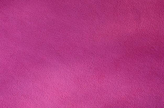 La couverture en tissu polaire rose à fourrure. texture de fond en tissu molletonné en peluche douce rose pâle Photo Premium