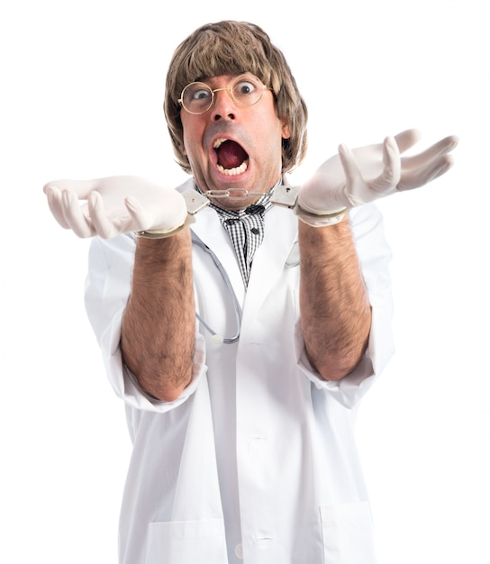 Crazy Doctor With Handcuffs Photo gratuit