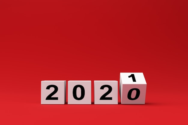 Cubes Blancs Avec L'inscription 2020 Est Remplacé Par 2021 Sur Fond Rouge, Rendu 3d Photo Premium