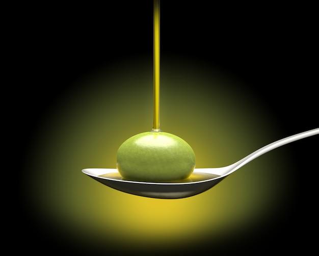 Une Cuillère Avec Une Olive Sous Une Chute D'huile Photo Premium