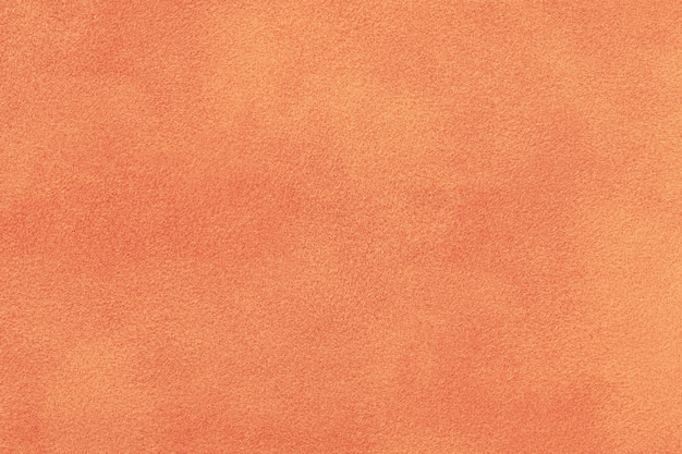 Daim mat corail. fond de texture de velours Photo Premium