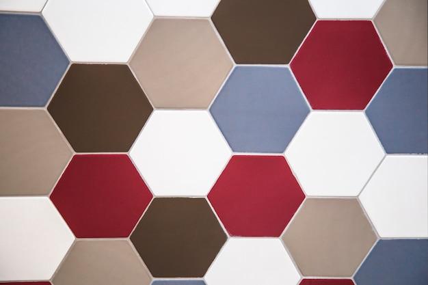 Dalle de mur tuile hexagonale rouge bleu et marron Photo Premium