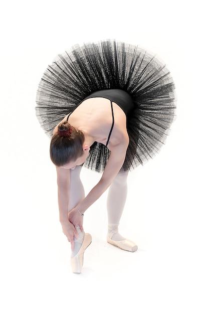 Danseur de ballet posant sur fond blanc Photo Premium