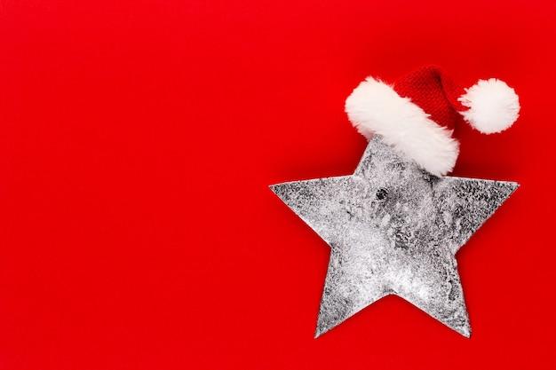 Décor D'étoile De Noël Sur Fond De Couleur Pastel Noël Ou Nouvel An Concept Minimal Photo Premium